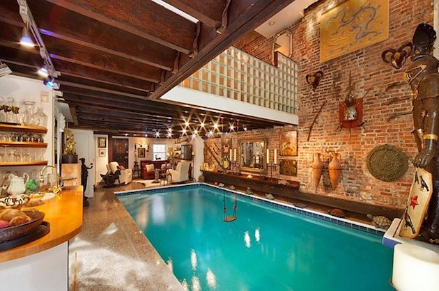 Manhattan Home With A Swimming Pool In The Middle Of The Living Room