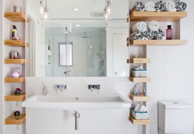 small bathroom with wooden shelves