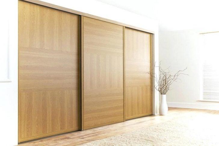 large bedroom closet with sliding door