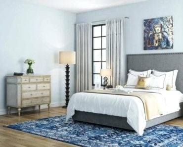 bright modern bedroom with wall art