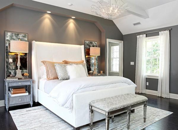bedroom with large white headboard