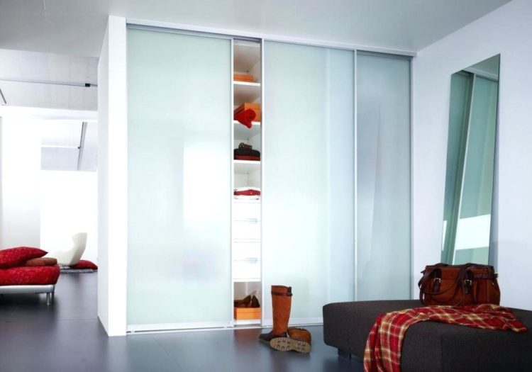 bedroom closet with glass sliding doors
