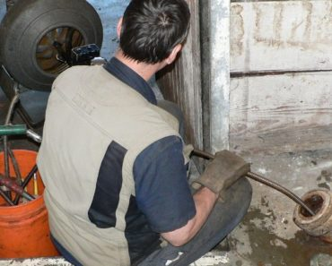 Using a Toilet Auger